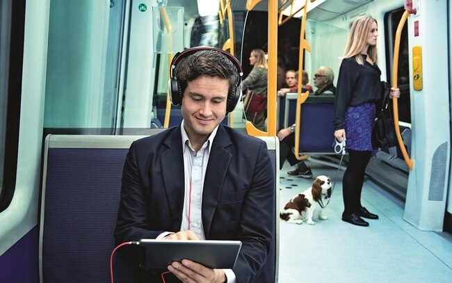 Man wearing Evolve 80 with active noise cancellation in the metro