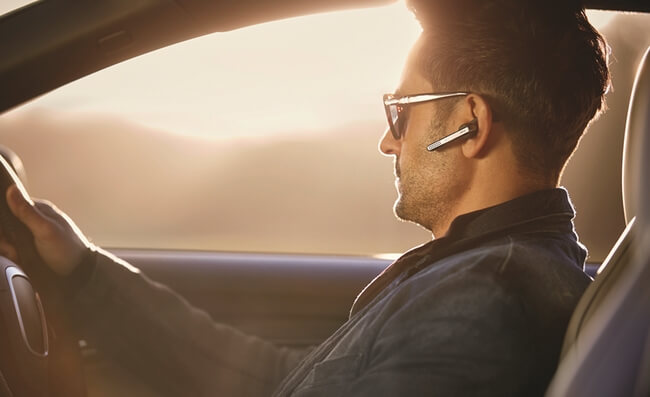 Are Bluetooth headsets safe: Man in car with Jabra Stealth headset